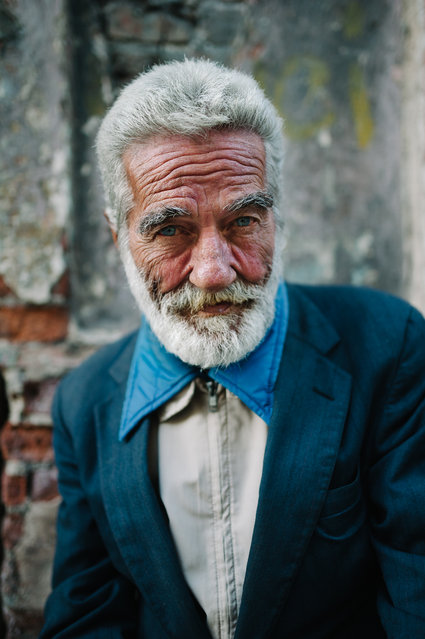 """Sean Connery from Cuba"". As I was passing by the streets of Havana Vieja I noticed a face staring at me. I kindly asked for a portrait on my bad Spanish, but it turned out he spoke English pretty well. He's 85 years old, and there's a lot of life left in him. I asked him if there's something he regrets, he said yes. Being born somewhere else. Photo location: Habana Vieja district,  Cuba. (Photo and caption by Marko Marinkovic/National Geographic Photo Contest)"