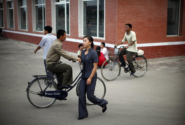 A woman walks in central Rason city, northeast of Pyongyang, August 29, 2011. (Photo by Carlos Barria/Reuters)