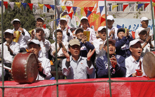 North Korean workers cheer as they celebrate May Day at the Pyongyang Thermal Power Complex in Pyongyang, North Korea, Monday, May 1, 2017. International Workers' Day, which is also known as Labor Day in some countries, is being celebrated worldwide. (Photo by Jon Chol Jin/AP Photo)