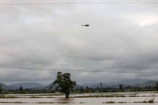 A military helicopter used to deliver food is seen flying over flodded fields in Kawlin township, Sagaing division, Myanmar, July 21, 2015. (Photo by Soe Zeya Tun/Reuters)