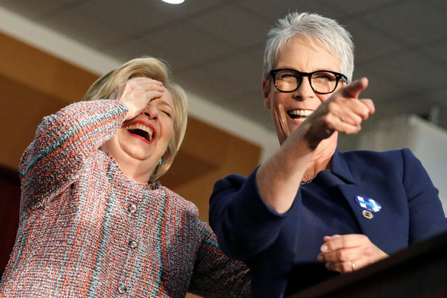 U.S. Democratic presidential candidate Hillary Clinton (L) and actress Jamie Lee Curtis react as two supporters take their tops off at the UFCW Union Local 324 in Buena Park, California, U.S. May 25, 2016. (Photo by Lucy Nicholson/Reuters)