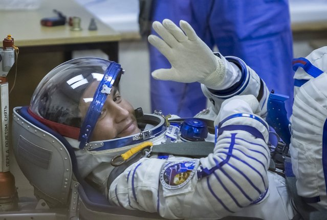 The International Space Station (ISS) crew member Kjell Lindgren of the U.S. waves during his space suit check at the Baikonur cosmodrome, Kazakhstan, July 22, 2015. (Photo by Shamil Zhumatov/Reuters)