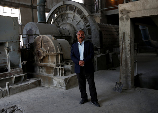 Mohammad Hakim Mohammadi, the general director of the Jabal Saraj cement factory, poses for a photograph in Jabal Saraj, north of Kabul, Afghanistan May 8, 2016. (Photo by Ahmad Masood/Reuters)