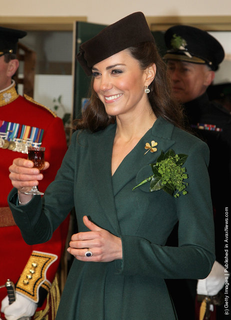 Catherine, Duchess of Cambridge holds a glass of Harvey's Bristol Creme in the Junior's Mess as she visits Aldershot Barracks on St Patrick's Day