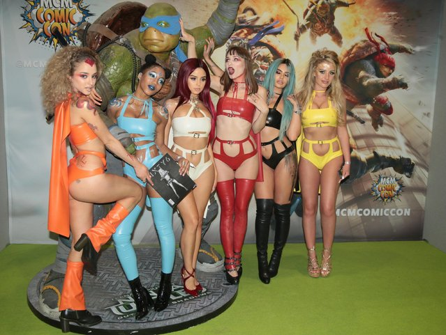 Comic enthusiasts dressed in fiction characters costumes attend MCM Comic Con at ExCeL convention centre in London, United Kingdom on May 26, 2017. (Photo by Alamy Stock Photos)