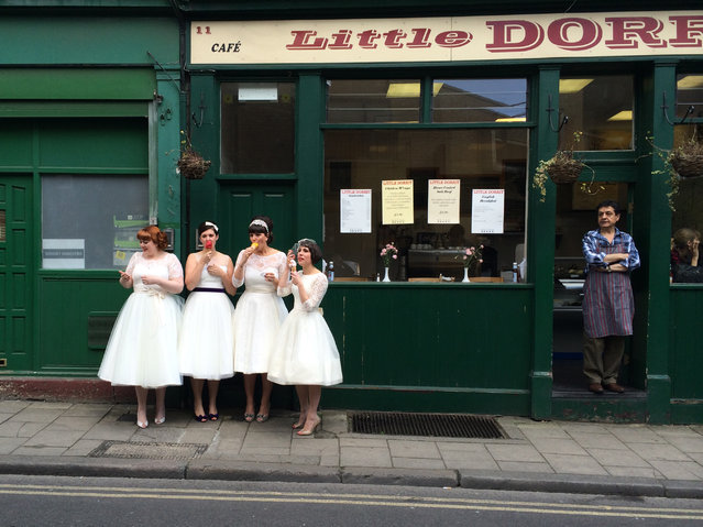 """Ladies in waiting"". While exploring Burough Market in London, I was delighted to come across four lovely young women dressed in vintage white dresses, eating ice cream as the local shopkeeper looked on. Are they brides? Or bridesmaids. I don't know, but they are obviously enjoying a very special day. Photo location: Burough Market, London, England. (Photo and caption by Susie Stern/National Geographic Photo Contest)"