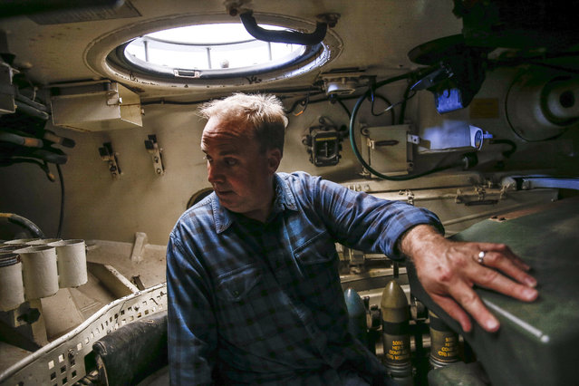 In this May 24, 2017, photo, Scott Jones looks around the inside of a tank during an Allies and Axis all-day DriveTanks.com experience at Ox Ranch in Uvalde, Texas. (Photo by Michael Ciaglo/Houston Chronicle via AP Photo)