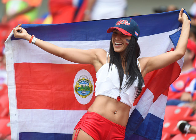 A Costa Rica fan cheers prior to a Group D football match between Italy and Costa Rica at the Pernambuco Arena in Recife during the 2014 FIFA World Cup on June 20, 2014. (Photo by Emmanuel Dunand/AFP Photo)