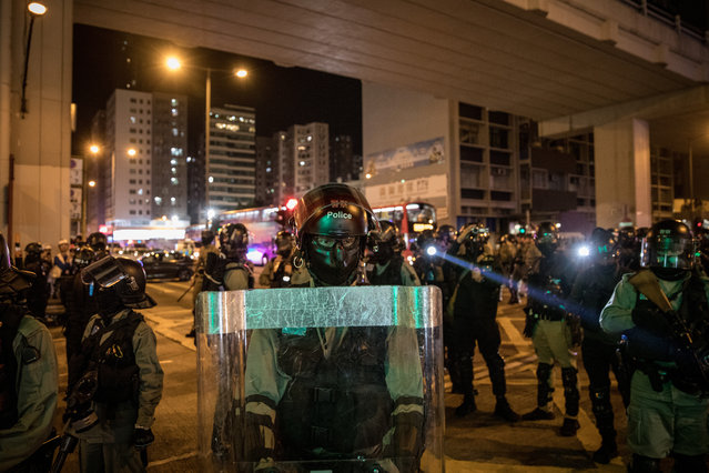 """Police disperse pro-democracy protesters outside the Prince Edward MTR station on November 30, 2019 in Hong Kong, China. Demonstrations in Hong Kong stretched into its sixth month as pro-democracy groups won the recent District Council elections, continuing demands for an independent inquiry into police brutality, the retraction of the word """"riot"""" to describe the rallies, and genuine universal suffrage. (Photo by Chris McGrath/Getty Images)"""