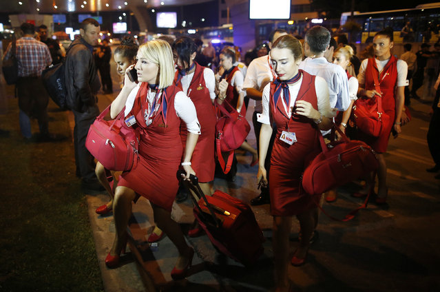 Members of a flight crew leave Istanbul's Ataturk airport, early Wednesday, June 29, 2016. (Photo by Emrah Gurel/AP Photo)