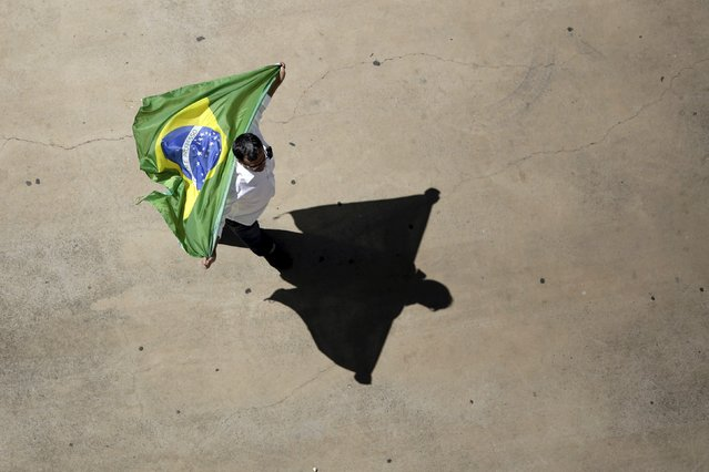 A demonstrator attends a protest against Brazil's President Dilma Rousseff, part of nationwide protests calling for her impeachment, at Esplanade of Ministries in Brasilia, Brazil, August 16, 2015. (Photo by Ueslei Marcelino/Reuters)