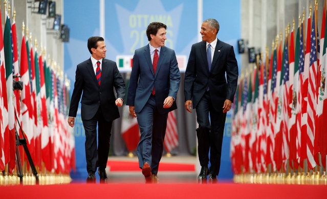 Mexican President Enrique Pena Nieto (L), Canadian Prime Minister Justin Trudeau (C) and U.S. President Barack Obama walk together at the National Gallery of Canada at the start of the North American Leaders' Summit in Ottawa, Canada June 29, 2016. (Photo by Kevin Lamarque/Reuters)