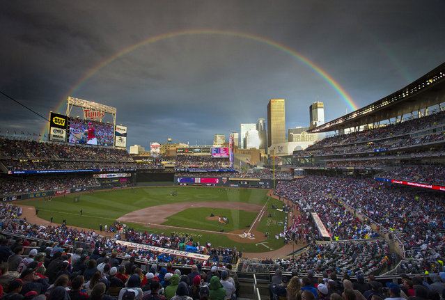 American League's Brian Dozier, of the Minnesota Twins, took the plate following a rain delay in the MLB All-Star baseball Home Run Derby, Monday, July 14, 2014, in Minneapolis. (Photo by Brian Mark Peterson/AP Photo/The Star Tribune)