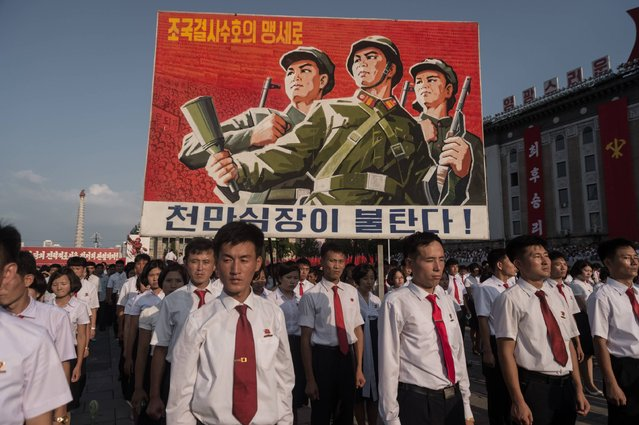 "A propaganda poster is diplsyed during a rally in support of North Korea's stance against the US, on Kim Il-Sung square in Pyongyang on August 9, 2017. US President Donald Trump said the United States' nuclear arsenal was ""more powerful than ever"" in a fresh warning to North Korea over its repeated missile tests. (Photo by Kim Won-Jin/AFP Photo)"