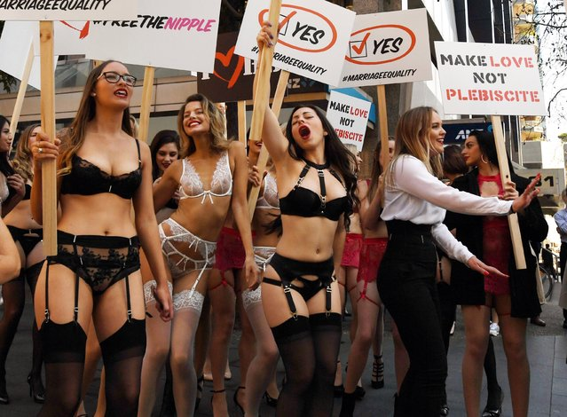 The incredible march was arranged by underwear brand Honey Birdette whose founder and CEO is gay in Sydney, Australia on August 14, 2017. On Monday, 60 Honey Birdette employees took to the streets of the Sydney CBD in support for marriage equality ahead of the federal government's controversial postal plebiscite on the topic, with forms slated to arrive in Australians' mailboxes on September 12. (Photo by PA Wire)
