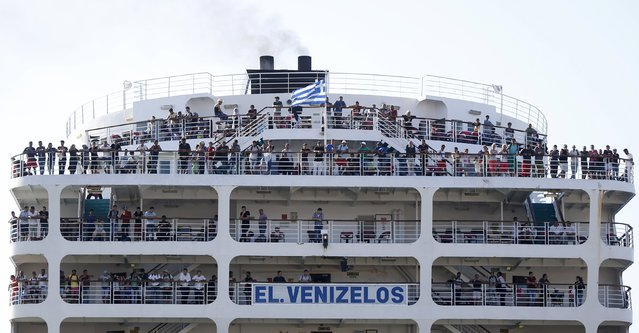 """Syrian refugees are seen onboard passenger ship """"Eleftherios Venizelos"""" as the ship arrives at the port of Piraeus near Athens, Greece, August 20, 2015. (Photo by Stoyan Nenov/Reuters)"""
