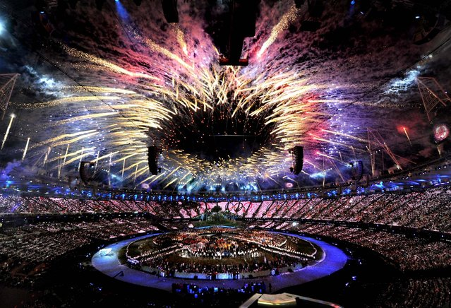 Fireworks light up the Olympic Stadium during the opening ceremony for the 2012 Summer Olympics in London on Juky 27, 2012. (Photo by Anthony Devlin/PA)