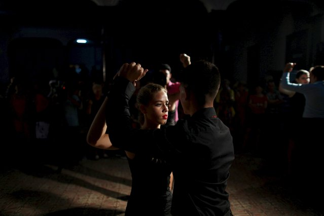 Youths dance during the 9th International Festival Danzon at a community center in Madruga, Cuba, June 27, 2015. (Photo by Alexandre Meneghini/Reuters)