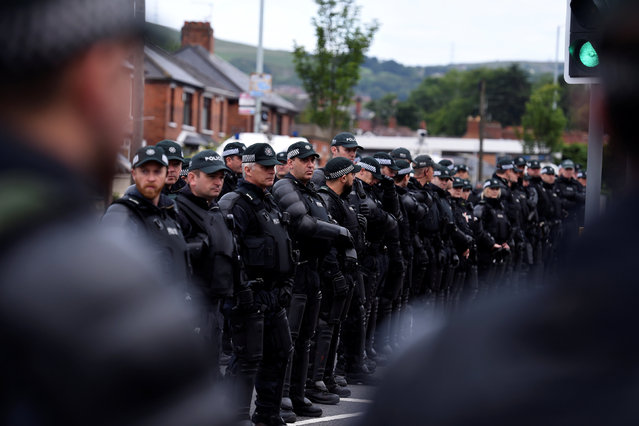 Members of the PSNI are seen in a stand off with the Greater Ardoyne Residents Coalition GARC as they wait for the Twelfth of July Orange Order March to come down the Crumlin Road in Belfast, Northern Ireland, July 12, 2016. (Photo by Clodagh Kilcoyne/Reuters)