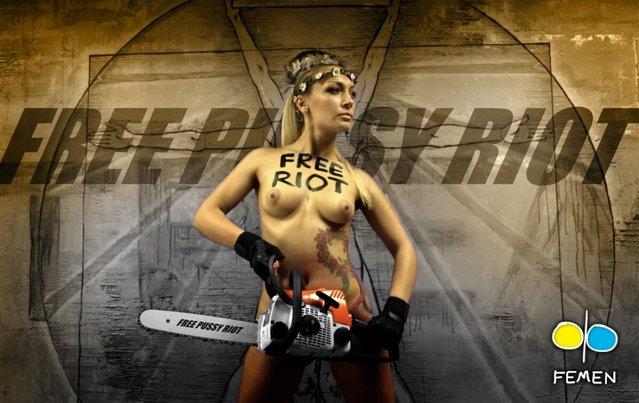 Ukraine FEMEN-activist Cuts Down Cross in Russian Female Punk Rock Band Protest