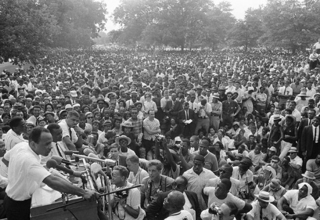 In this June 26, 1966 file photo, James Meredith, lower left, whose Mississippi March began in Memphis, Tenn., on June 5 and was interrupted when he was shot the following day, addresses a mass rally of civil rights demonstrators from the Mississippi State Capitol grounds in Jackson, Miss. The March Against Fear in the summer of 1966 helped many find a voice to protest the injustices of the day, setting an example for contemporary movements such as Black Lives Matter, five decades later. (Photo by AP Photo)