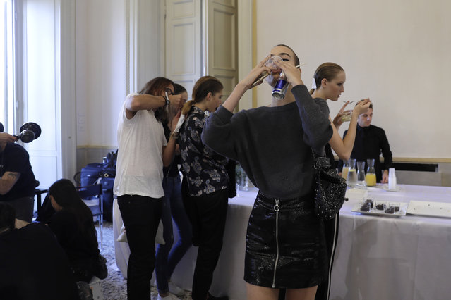 Models prepare backstage prior to the Roberto Cavalli womens Fall/Winter 2018/19 fashion collection, presented in Milan, Italy, Friday, September 22, 2017. (Photo by Luca Bruno/AP Photo)