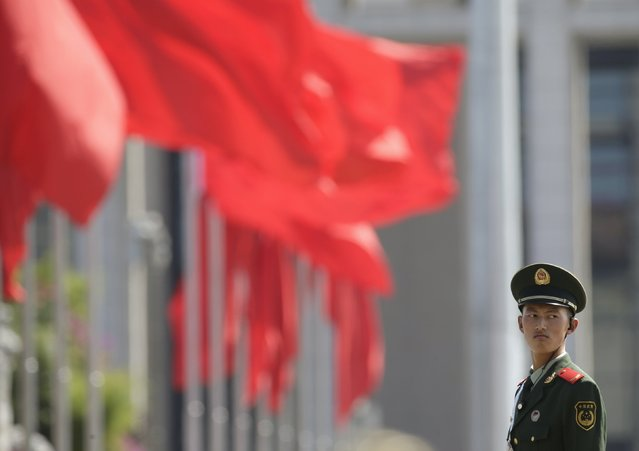 A paramilitary policeman stands guard on Beijing's Tiananmen Square September 2, 2015. Beijing is battening down the hatches and crank. (Photo by Jason Lee/Reuters)