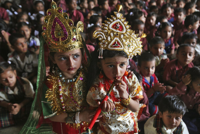 "School children dressed as Lord Krishna (R) and Goddess Radha, take part during the celebrations on the eve of the Hindu festival ""Janmashtami"" in Jammu August 9, 2012. (Photo by Mukesh Gupta/Reuters)"