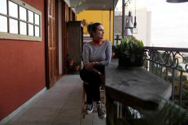 """Gabriela Galvao, a 40-year-old businesswoman, poses for a portrait at her home in Rio de Janeiro, Brazil, June 27, 2016. When asked what she thought about Rio de Janeiro hosting the Olympics, Gabriela said, """"The city of Rio de Janeiro always had bad services and the image of a disordered and violent city, but during the Olympics tourists will get the best impression because they come looking for fun"""". (Photo by Pilar Olivares/Reuters)"""