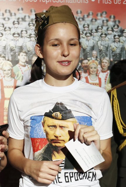 A Russian woman attending a Russian Red Army Choir performance wears a T-shirt with a picture of Russian President Vladimir Putin at Water Front Theatre in Beirut September 13, 2014. (Photo by Jamal Saidi/Reuters)