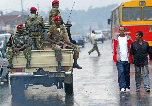 In this June 10, 2005 file photo, members of the Ethiopian army patrol the streets of Addis Ababa, Ethiopia, after recent clashes with protesters. Violent weekend clashes between protesters and security forces have claimed the lives of more than a dozen people across Ethiopia. The government announced Sunday, August 7, 2016 that seven protesters died in the northern Amhara region's capital, Bahir Dar. Witnesses who spoke to The Associated Press anonymously for fear of reprisals said anti-riot police also used force Saturday to disperse hundreds of protesters in the capital, Addis Ababa. (Photo by Karel Prinsloo/AP Photo)