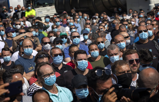 Nissan workers gather during a protest in front of the Nissan factory in Barcelona, Spain, Thursday, May 28, 2020. Japanese carmaker Nissan Motor Co. has decided to close its manufacturing plans in the northeastern Catalonia region, resulting in the loss of some 3,000 direct jobs. (Photo by Emilio Morenatti/AP Photo)