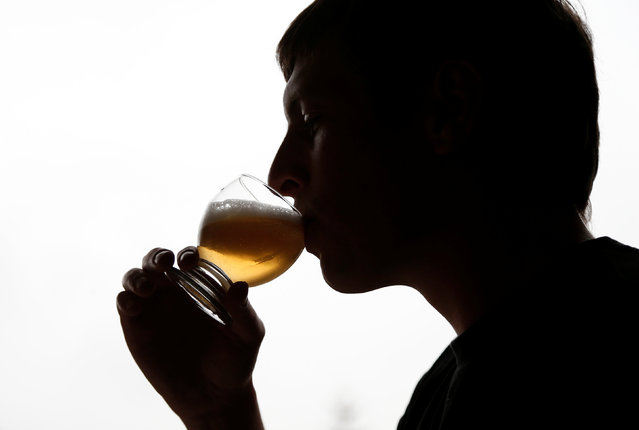Arnaud Laloy, member of the Belgian Homebrewers association, tastes his own beer as he starts brewing in the garage of his house in Neufchateau, Belgium, August 11, 2016. (Photo by Francois Lenoir/Reuters)