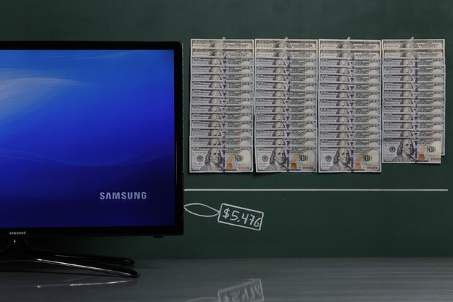 """A Samsung 32"""" plasma TV as photographed in a studio with an illustrative price tag of $5,476 (US dollars), equivalent to the Bs. 34,500 (bolivars) that it costs on average to purchase in Caracas at the official exchange rate of 6.3 bolivars per dollar, in Caracas September 29, 2014. (Photo by Carlos Garcia Rawlins/Reuters)"""