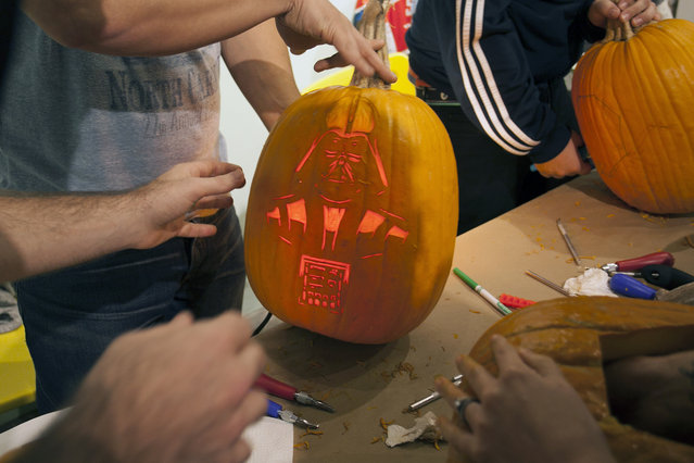 Light was inserted into a close to be finished Darth Vader pumpkin at Cotton Candy Machine in Brooklyn, N.Y. on October 18, 2014. (Photo by Siemond Chan/Yahoo Finance)