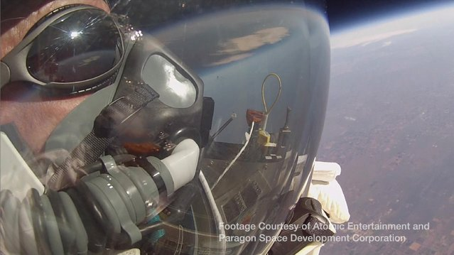 Google's vice president Alan Eustace looks out of his spacesuit into the stratosphere prior to a record-breaking skydive over New Mexico, in this still image taken from video October 24, 2014, a handout courtesy of the Paragon Space Development Corporation. Eustace was lifted up 135,890 ft (41,420 metres) by an enormous balloon while wearing a specially designed pressurized space suit, the Paragon Space Development Corporation said. (Photo by Reuters/Paragon Space Development Corporation)
