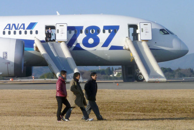In this photo taken by a passenger and distributed by Japan's Kyodo News, passengers leave an All Nippon Airways Boeing 787 after it made an emergency landing at Takamatsu airport in Takamatsu, Kagawa Prefecture, western Japan, Wednesday, January 16, 2013. ANA said a cockpit message showed battery problems and a burning smell was detected in the cockpit and the cabin, forcing the 787 on a domestic flight to land at the airport. (Photo by AP Photo/Kyodo News)