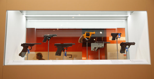 Replica and real guns used in crimes are displayed for the Crime Museum Uncovered exhibition at the Museum of London in the City of London, Wednesday, October 7, 2015. (Photo by Alastair Grant/AP Photo)