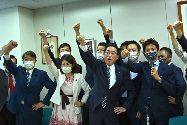 Japan's ruling Liberal Democratic Party (LDP) Policy Research Council's chairman Fumio Kishida (1st row - 2nd R) raises his fist in the air with his faction members after announcing his candidacy for LDP leadership during a meeting in Tokyo on September 1, 2020. Japan's ruling party will vote September 14, 2020 on a replacement for Prime Minister Shinzo Abe, the country's longest-serving premier, who is resigning for health reasons, local media reported on September 1, 2020. (Photo by Charly Triballeau/AFP Photo)