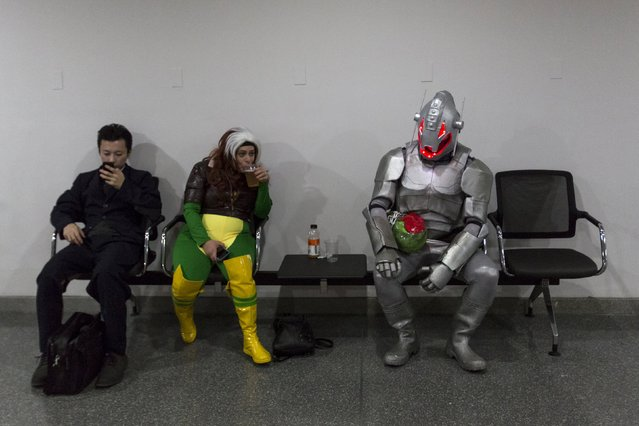 Jason Ong (R) sits in an Ultron costume on day two of New York Comic Con in Manhattan, New York, October 9, 2015. The event draws thousands of costumed fans, panels of pop culture luminaries and features a sprawling floor of vendors in a space equivalent to more than three football fields at the Jacob Javits Convention Center on Manhattan's West Side. (Photo by Andrew Kelly/Reuters)
