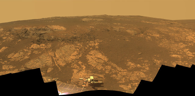 "As Opportunity reached the ninth anniversary of its landing on Mars, the rover was working in the Matijevic Hill area, seen in this view from Opportunity's Pancam. Opportunity landed January 24, 2004. The landing site was about 12 miles (19 kilometers), straight-line distance, or about 22 miles (35.5 kilometers) driving-route distance, from this location on the western rim of Endeavour Crater. The field of view encompasses most of the terrain traversed by Opportunity during a ""walkabout"" in October and November 2012 to scout which features to spend time examining more intensely. (Photo by NASA/JPL-Caltech/Cornell/ASU/The Atlantic)"
