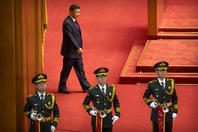 Chinese President Xi Jinping, rear, arrives for an event to honor some of those involved in China's fight against COVID-19 at the Great Hall of the People in Beijing, Tuesday, September 8, 2020. Chinese leader Xi Jinping is praising China's role in battling the global coronavirus pandemic and expressing support for the U.N.'s World Health Organization, in a repudiation of U.S. criticism and a bid to rally domestic support for Communist Party leadership. (Photo by Mark Schiefelbein/AP Photo)