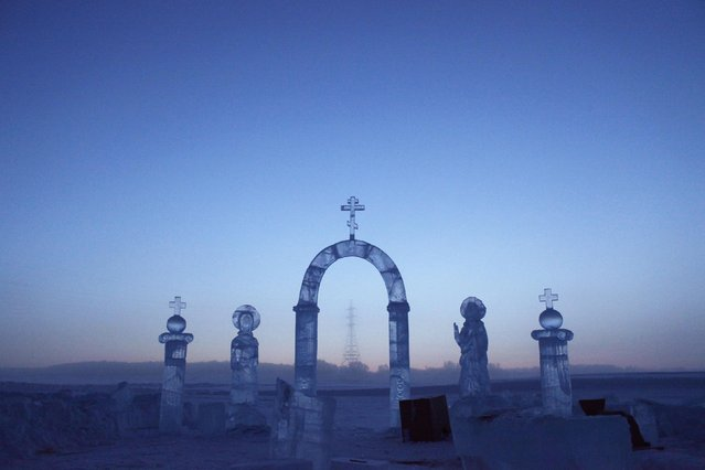 A view shows ice sculptures on the Lena river, constructed for the celebration of Orthodox Epiphany outside Yakutsk in the Republic of Sakha, northeast Russia, January 17, 2013. The coldest temperatures in the northern hemisphere have been recorded in Sakha, the location of the Oymyakon valley, where according to the United Kingdom Met Office a temperature of -67.8 degrees Celsius (-90 degrees Fahrenheit) was registered in 1933 – the coldest on record in the northern hemisphere since the beginning of the 20th century. Yet despite the harsh climate, people live in the valley, and the area is equipped with schools, a post office, a bank, and even an airport runway (albeit open only in the summer). (Photo by Maxim Shemetov/Reuters)
