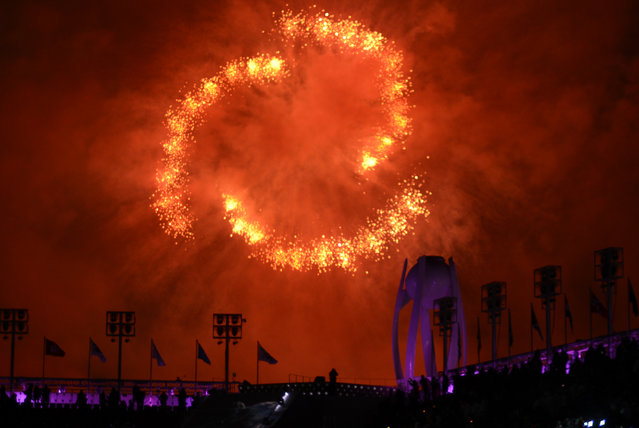 Fireworks explode behind the extinguished Olympic Cauldron near the conclusion of the Closing Ceremony of the Pyeongchang 2018 Winter Olympic Games at Pyeongchang Olympic Stadium. February 25, 2018. (Photo by Hyoung Chang/The Denver Post)