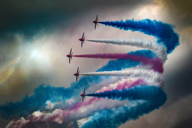 """Red Arrows"" at the 2016 royal air tattoo, RAF Fairford, UK. By Jonny Williams, finalist: action. (Photo by Jonny Williams/UK National Geographic Traveller Photography Competition 2018)"