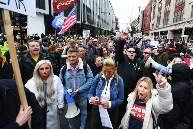 People march during a Standupx protest against coronavirus lockdown restrictions in Oxford Street in London, United Kingdom on October 17, 2020. (Photo by James Veysey/Rex Features/Shutterstock)