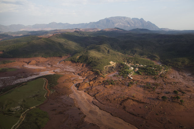 Aerial view of the debris and mud on Thursday, at the small town of Bento Rodrigues after a dam burst in Minas Gerais state, Brazil, Friday, November 6, 2015. (Photo by Felipe Dana/AP Photo)