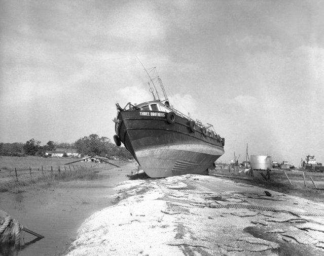 The fishing schooner three brothers rests high and dry on a road after it was tossed from the water as hurricane Audrey ripped through south Louisiana coastal town in Cameron, La., on June 28, 1957. Many boats were tossed ashore or sunk during the first hurricane of the season. (Photo by Randy Taylor/AP Photo)