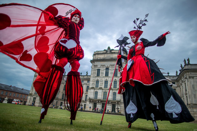 """Dancers of the Art Tremendo dance company perform in front of the Ludwigslust's castle, northern Germany on April 13, 2018, during an event to promote the """"Small festival in a big park"""" festival to be held on August 10 and 11. (Photo by Jens Büttner/AFP Photo/DPA)"""