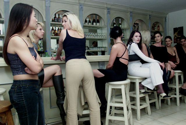 Reuters South Africa-based photographer Juda Ngwenya who documented Nelson Mandela's historic rise to power died on Wednesday. Here: Prostitutes wait at a bar in a plush northern suburb of Johannesburg August 22, 2002. (Photo by Juda Ngwenya/Reuters)